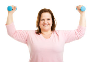 Smiling woman using hand weights
